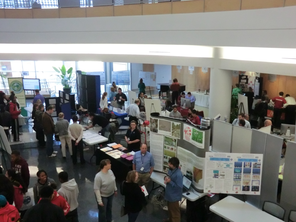 Photography of GISday at the National Weather Center. Several booths and atendees can be seen